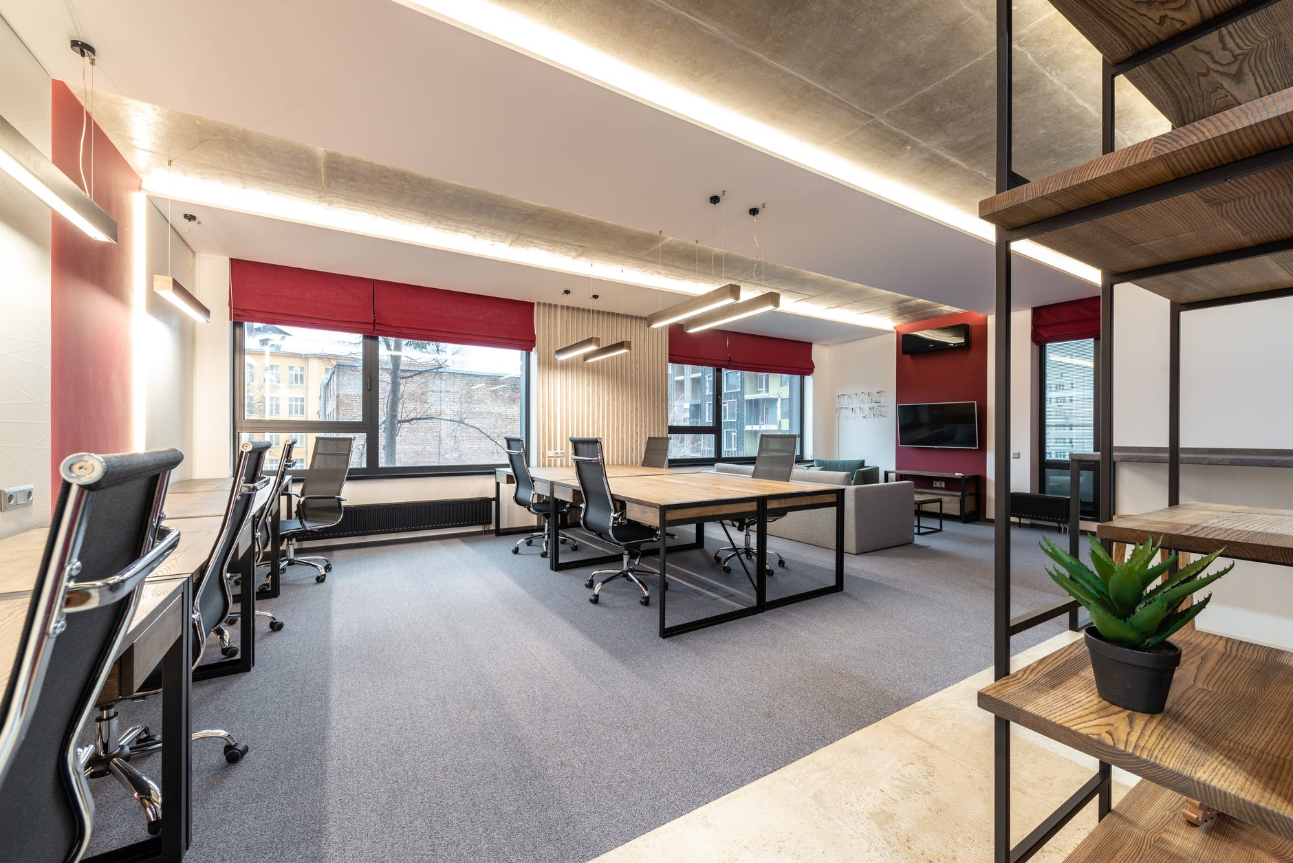 office with tables and chairs near windows